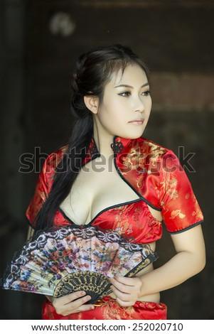 Sexy Chinese woman red dress traditional cheongsam - stock photo