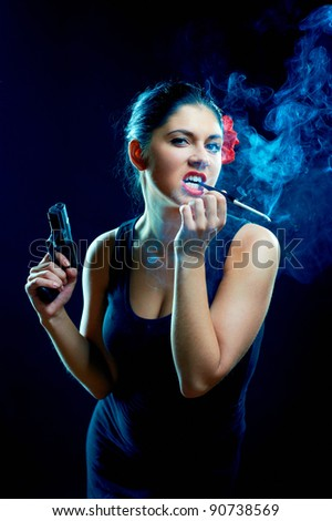 Sexy chiquita with cigarette and gun