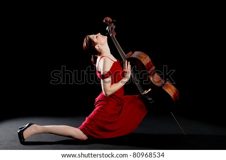 Sexy concept of a young woman dancing the tango wit a cello