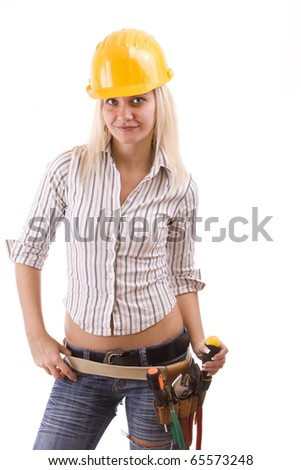 Sexy construction worker with tool bag and a lot of equipment suspenders a jeans