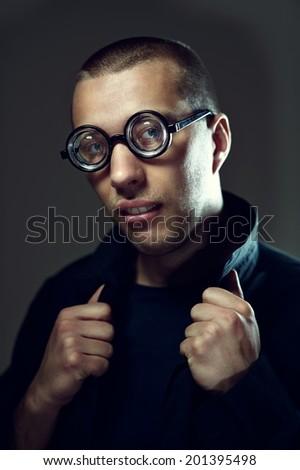 Sexy, cool nerd in glasses flirting - stock photo