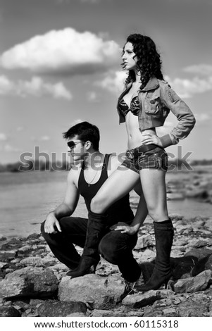 sexy couple by the beach - stock photo