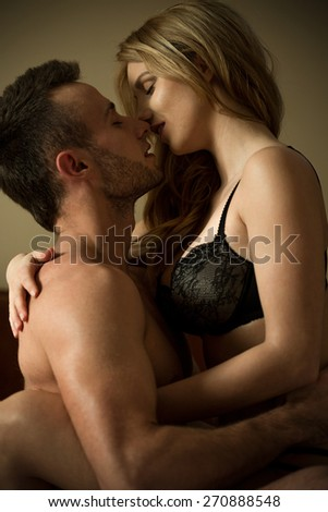 Sexy couple during intimate moments in bedroom - stock photo