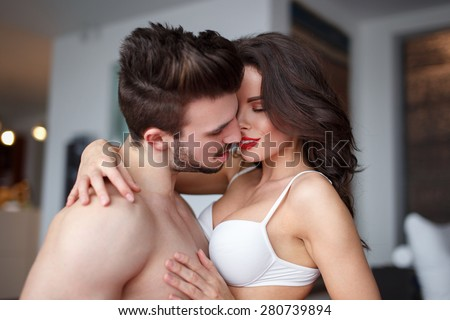 Sexy couple foreplay at home, hot milf with young lover - stock photo