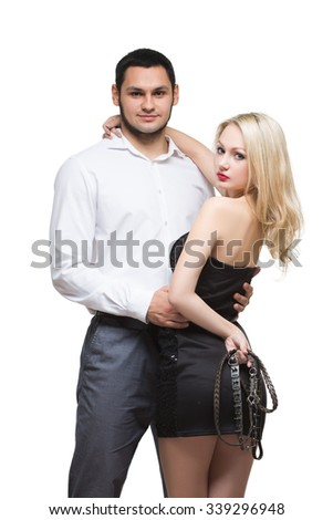 sexy couple. girl holding a leash. Isolated on white background
