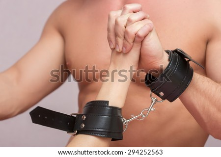 sexy couple handcuffed. sex Toys