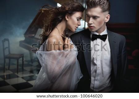 Sexy couple hugging - stock photo