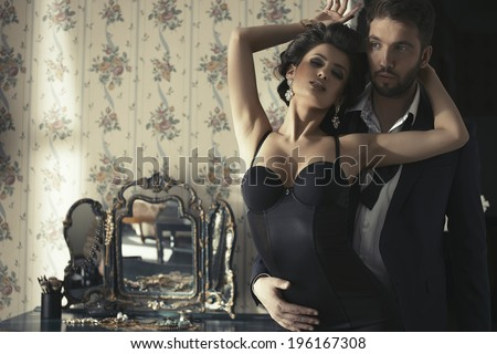 Sexy couple in bedroom  - stock photo