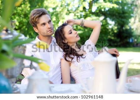 Sexy couple in garden - stock photo