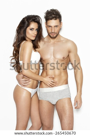 Sexy couple in lingerie - stock photo