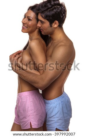 sexy couple in love wearing boxers on white background