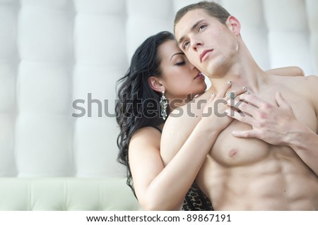 Sexy couple in romantic pose - stock photo