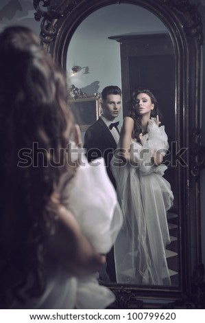Sexy couple in the mirror - stock photo