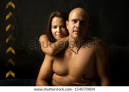 Sexy couple isolated in a black background