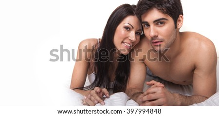 sexy couple looking at the camera smiling , 