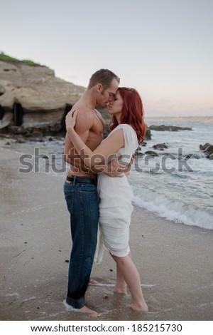 Sexy Couple on Beach - stock photo