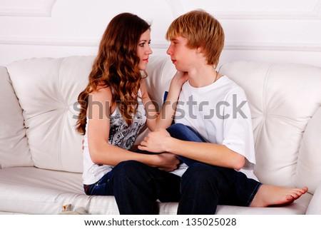 Sexy couple on white background - stock photo