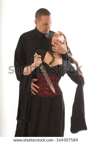 Sexy Couple with Dagger - stock photo