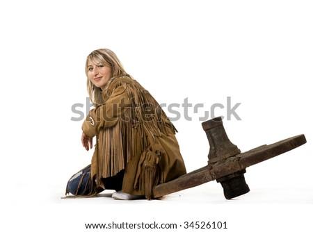Sexy cow girl sitting on cart-wheel - stock photo