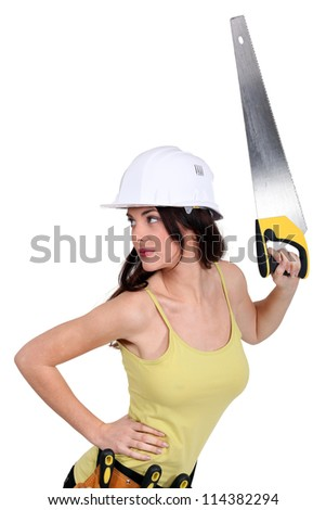 sexy craftswoman holding a handsaw