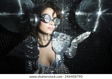 sexy disco party woman dressed in a unique silver costume with metal wings. Perfect for stylish club, disco and fashion events  - stock photo