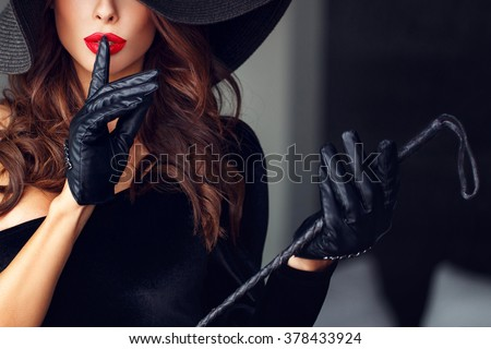 Sexy dominant woman showing no talk, bdsm - stock photo