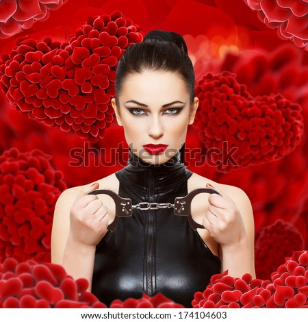 [Image: stock-photo-sexy-dominatrix-with-handcuf...104603.jpg]