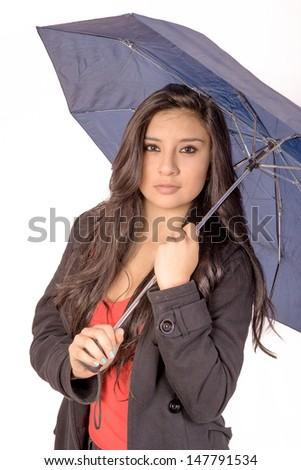 Sexy elegant young hispanic woman posing with umbrella - stock photo