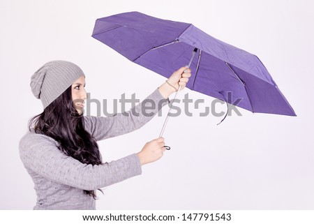 Sexy elegant young hispanic woman posing with umbrella