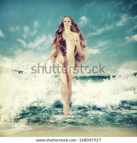 Sexy fairy slim woman with long curly hair - Aphrodite is in sea water in a spray of sea waves