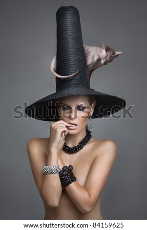 sexy fairy with a cat on a big hat