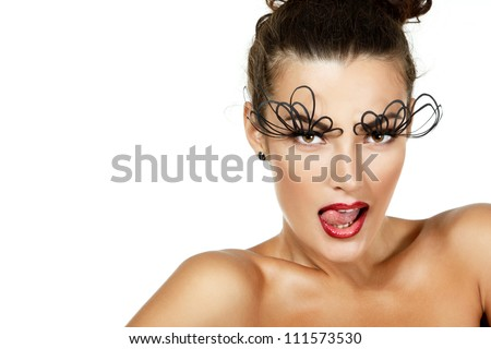 sexy fashion girl with decorative eye lushes and red lipstick lick her lips with tongue, isolated - stock photo