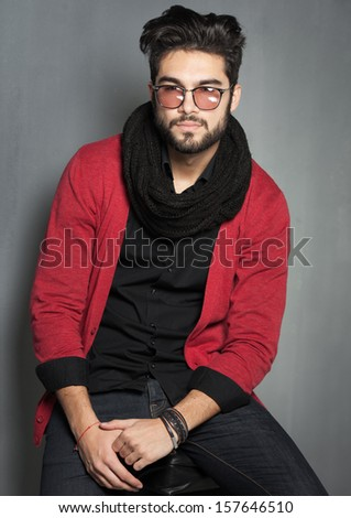 sexy fashion man model dressed casual posing dramatic in the studio - stock photo