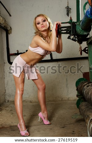 Sexy fashion model changing occupation to plumber - stock photo