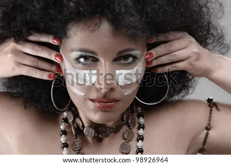 Sexy fashion model face with african style make-up - stock photo
