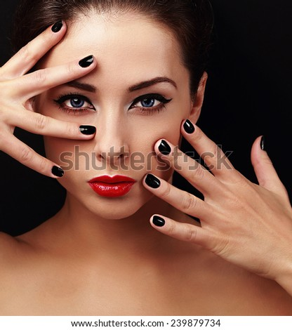 Sexy fashion model with bright makeup and black manicure on hands. Beauty health skin. Closeup portrait on black - stock photo