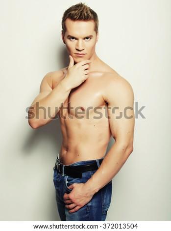 Sexy fashion portrait of a hot male model  - stock photo
