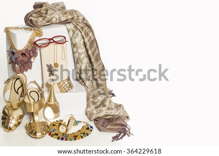 Sexy fashionable shoes with handbag and golden jewelry on white background. - stock photo