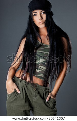 sexy fashionable woman in military uniform