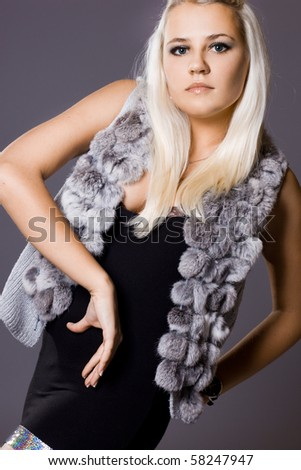 Sexy fashionable woman on grey background