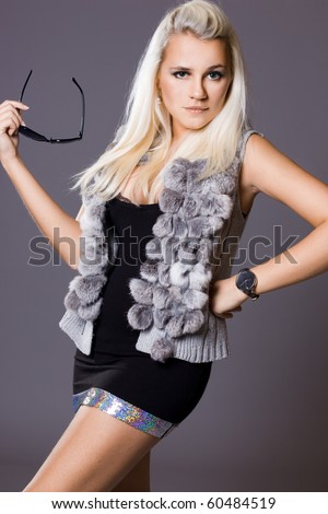 Sexy fashionable woman with fur waistcoat