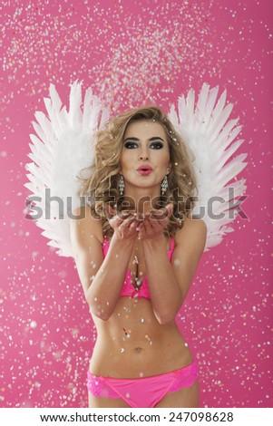 Sexy female angel celebrate on Valentine's day - stock photo