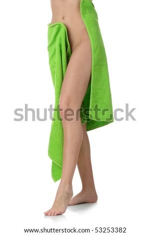 Sexy female body in green towel - stock photo