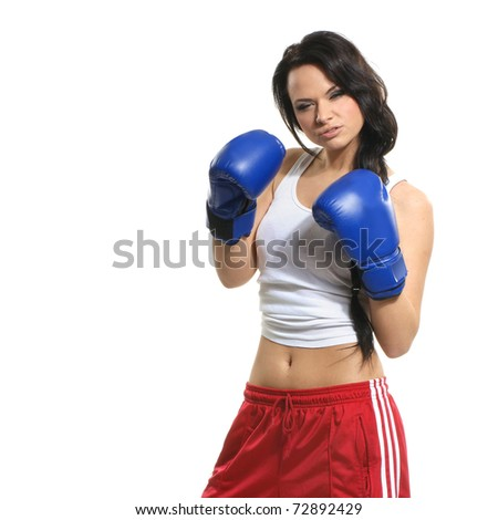 Sexy female fighter isolated on white background - stock photo