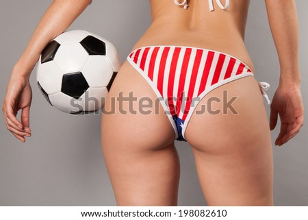 sexy female holding soccer ball  - stock photo