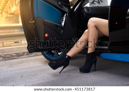 sexy female legs in a car