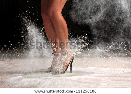 Sexy female legs jumping in the dust - stock photo