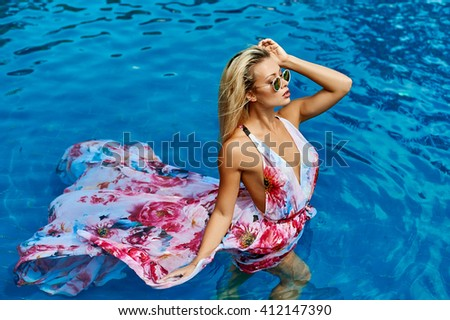 Sexy female model posing in the pool