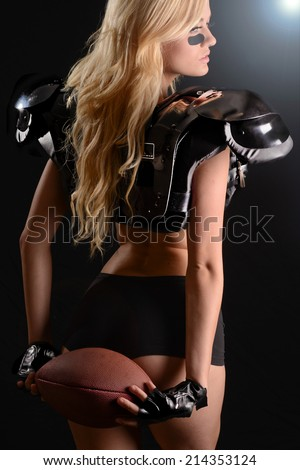 Sexy Fierce young woman Football Player - stock photo