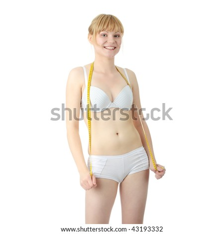 Sexy, fit, young,blond woman in underwear measuring her body - stock photo